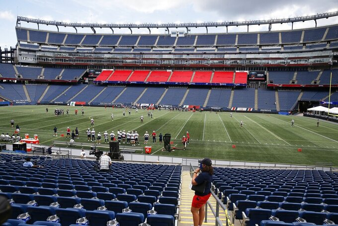 The New England Patriots take the field at Gillette Stadium for an NFL football training camp scrimmage, Friday, Aug. 28, 2020, in Foxborough, Mass. (AP Photo/Michael Dwyer, Pool)