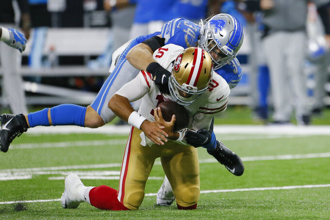 Detroit Lions middle linebacker Alex Anzalone (34) tackles San Francisco 49ers quarterback Jimmy Garoppolo (10) in the first half of an NFL football game in Detroit, Sunday, Sept. 12, 2021. (AP Photo/Duane Burleson)