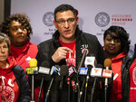 Chicago Teachers Union President Jesse Sharkey speaks during a news conference at the union's Near West Side headquarters, Wednesday, Oct. 30, 2019, in Chicago. The union's governing body has voted to accept a tentative agreement with Chicago Public Schools, but the union will remain on strike until Mayor Lori Lightfoot agrees to make up all 10 school days missed during the walkout. (Ashlee Rezin Garcia/Chicago Sun-Times via AP)