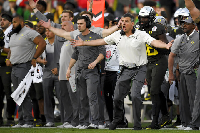 Oregon head coach Mario Cristobal reacts during second half of the Rose Bowl NCAA college football game against Wisconsin Wednesday, Jan. 1, 2020, in Pasadena, Calif. (AP Photo/Mark J. Terrill)