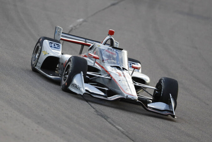 Will Power, of Australia, drives his car during an IndyCar Series auto race, Saturday, July 18, 2020, at Iowa Speedway in Newton, Iowa. (AP Photo/Charlie Neibergall)