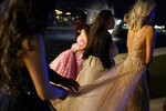 Young people attend prom at the Grace Gardens Event Center in El Paso, Texas on Friday, May 7, 2021. Around 2,000 attended the outdoor event at the private venue after local school districts announced they would not host proms this year. Tickets cost $45. (AP Photo/Paul Ratje)