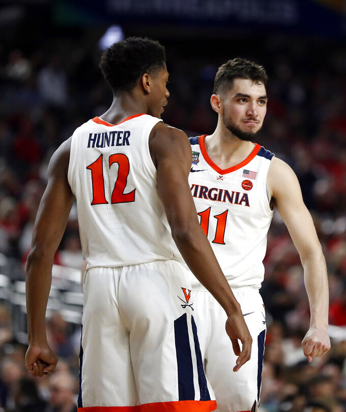 Virginia's Ty Jerome (11) and De'Andre Hunter (12) react during the second half in the semifinals of the Final Four NCAA college basketball tournament against Auburn, Saturday, April 6, 2019, in Minneapolis. (AP Photo/Jeff Roberson)