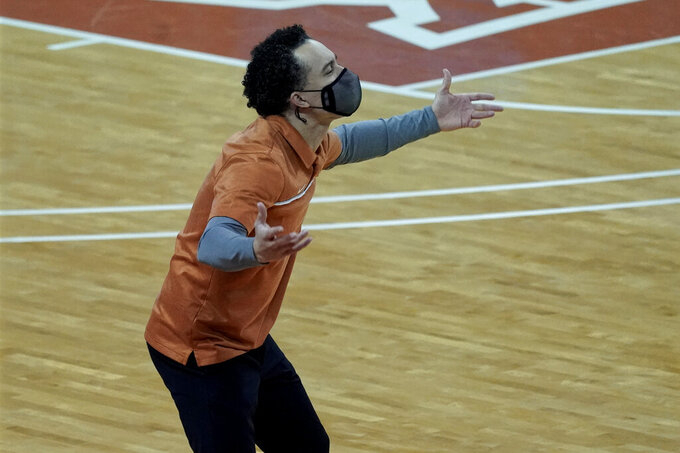 Texas head coach Shaka Smart directs his team against Kansas State during the second half of an NCAA college basketball game in Austin, Texas, Saturday, Jan. 16, 2021. (AP Photo/Chuck Burton)
