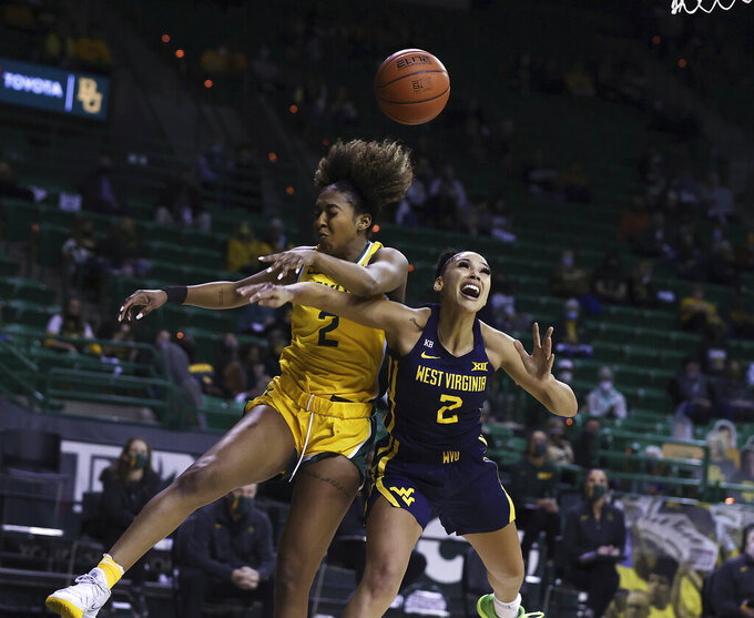 Baylor guard DiDi Richards, left, blocks the shot of West Virginia guard Kysre Gondrezick, right, in the first half of an NCAA college basketball game, Monday, March 8, 2021, in Waco, Texas. (Rod Aydelotte/Waco Tribune-Herald via AP)