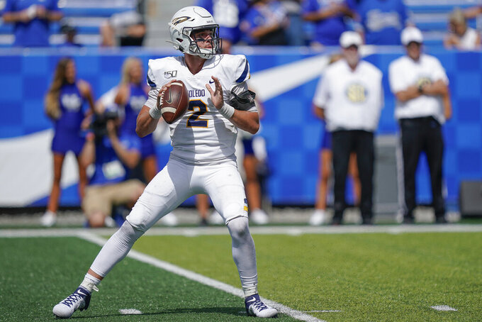 Toledo quarterback Carter Bradley (2) prepares to throw a pass during the second half of the NCAA college football game against Kentucky, Saturday, Aug. 31, 2019, in Lexington, Ky. (AP Photo/Bryan Woolston)