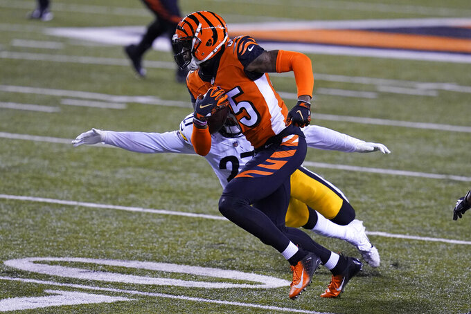Cincinnati Bengals' Tee Higgins (85) runs past Pittsburgh Steelers' Marcus Allen (27) during the first half of an NFL football game, Monday, Dec. 21, 2020, in Cincinnati. (AP Photo/Michael Conroy)
