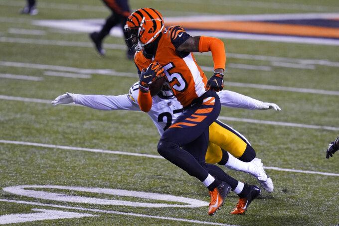 Cincinnati Bengals' Tee Higgins (85) runs past Pittsburgh Steelers' Marcus Allen (27) during the first half of an NFL football game, Monday, Dec. 21, 2020, in Cincinnati. (AP Photo/Michael Conroy)