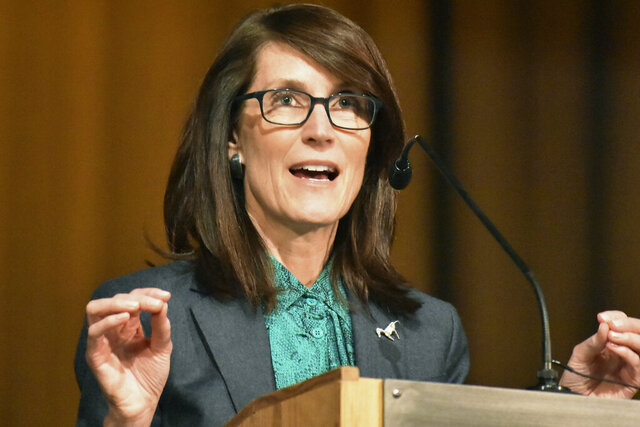 FILE - In this Wednesday, Feb. 12, 2020 file photo, Whitney Williams speaks at a forum for Democratic gubernatorial candidates at Montana State University Billings in Billings, Mont. Williams faces Lt. Gov. Mike Cooney in the June 2 primary election. (AP Photo/Matthew Brown, File)