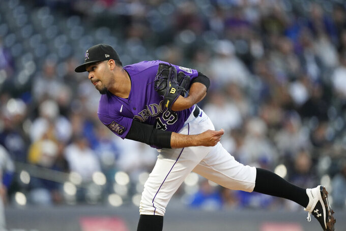 Colorado Rockies starting pitcher Antonio Senzatela works against the Los Angeles Dodgers in the first inning of a baseball game Tuesday, Sept. 21, 2021, in Denver. (AP Photo/David Zalubowski)