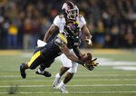 Iowa wide receiver Ihmir Smith-Marsette, front, works to bring in a reception as Minnesota defensive back Coney Durr trails during the second half of an NCAA college football game, Saturday, Nov. 16, 2019, in Iowa City, Iowa. (AP Photo/Matthew Putney)