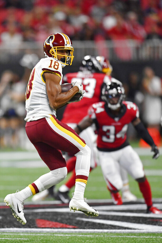 Washington Redskins wide receiver Josh Doctson (18) makes the catch against Atlanta Falcons defensive back Chris Cooper (34) during the first half an NFL preseason football game, Thursday, Aug. 22, 2019, in Atlanta. (AP Photo/Mike Stewart)
