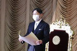 Japan's Emperor Naruhito wearing a face mask to protect against the coronavirus reads a statement to formally open an extraordinary Diet session at the upper house of parliament in Tokyo, Monday, Oct. 26, 2020. (AP Photo/Koji Sasahara)