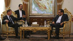 French presidential envoy Emmanuel Bonne, left, talks with Secretary of Iran's Supreme National Security Council Ali Shamkhani during their meeting in Tehran, Iran, Wednesday, July 10, 2019. An unidentified interpreter sits second left. (AP Photo/Vahid Salemi)