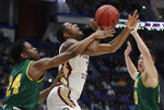 Florida State's Trent Forrest (3) passes the ball under pressure from Vermont's Ben Shungu (24) and Ernie Duncan, right, during the first half of a first round men's college basketball game in the NCAA Tournament, Thursday, March 21, 2019, in Hartford, Conn. (AP Photo/Elise Amendola)