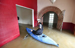 Jay Michael Tucker kayaks through the flooded Surrey Resort as the Russian River flows through it in Guerneville, Calif., on Friday, Feb. 15, 2019. Streets and low-lying areas flooded as the Russian River swelled above its banks Friday. (AP Photo/Josh Edelson)