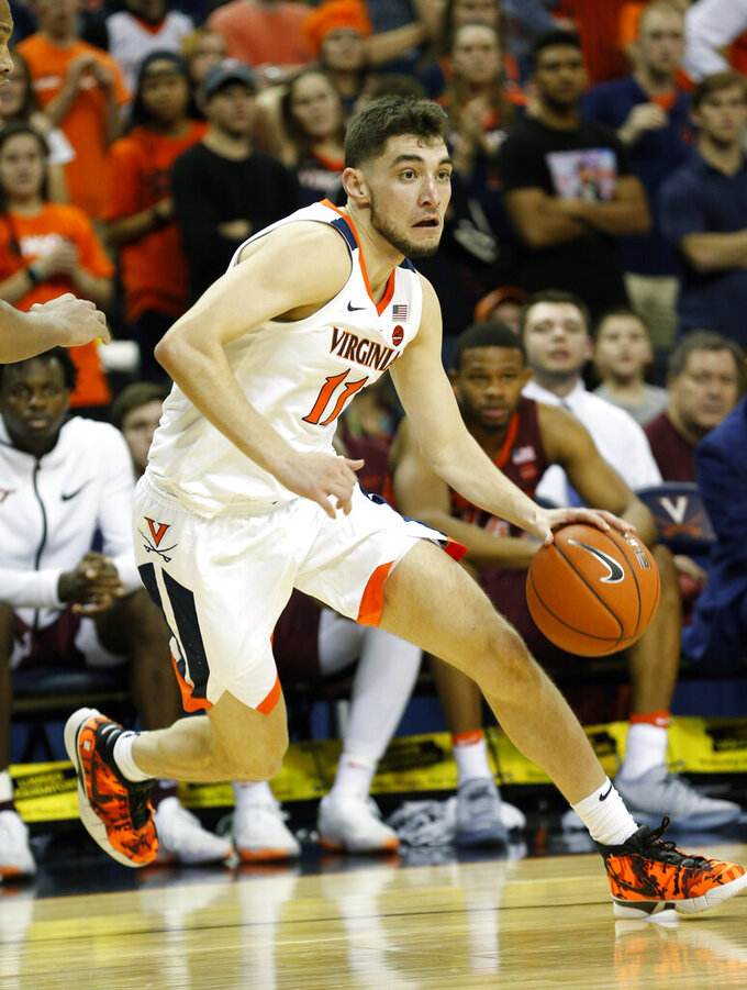 FILE - In this Jan. 15, 2019, file photo, Virginia guard Ty Jerome (11) drives to the basket during the first half of an NCAA college basketball game against Virginia Tech, in Charlottesville, Va. Jerome was named to the AP All-ACC team, Tuesday, March 12, 2019. (AP Photo/Steve Helber, File)