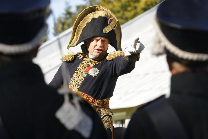 FILE - In this Sunday, Sept. 16, 2012 file photo, Oleg Sokolov, a history professor at St. Petersburg State University, wears a 1812-era French army general's uniforms during a staged battle re-enactment to mark the 200th anniversary of the battle of Borodino which in 1812 was the largest and bloodiest single-day action of the French invasion of Russia, in St.Petersburg, Russia. Police in the Russian city of St. Petersburg are planning to interrogate a prominent professor who has been detained on suspicion of killing a female student after being pulled from a frigid river on Saturday, Nov, 9, 2019 with a backpack containing severed arms. (AP Photo/Dmitri Lovetsky, File) (AP Photo/Dmitri Lovetsky, File)