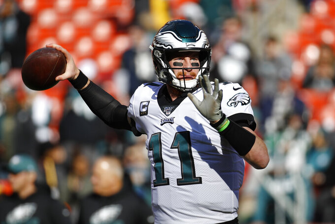 Philadelphia Eagles quarterback Carson Wentz (11) warming up before the start of an NFL football game against the Washington Redskins, Sunday, Dec. 15, 2019, in Landover, Md. (AP Photo/Patrick Semansky)