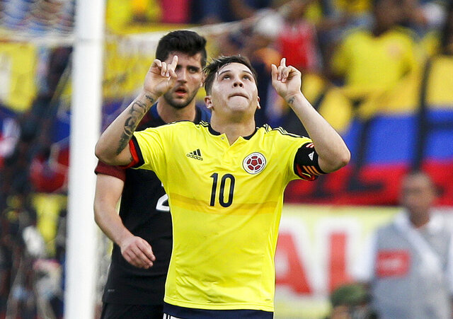 FILE - In this March 25, 2016, file photo, Colombia's Juan Fernando Quintero (10) celebrates after scoring from the penalty spot against the United States during an Olympic qualifying soccer match at the Roberto Melendez Stadium in Barranquilla, Colombia. The newly appointed chief of Colombia's army says he is willing to meet with soccer star Juan Fernando Quintero to discuss his father's disappearance more than 20 years earlier. (AP Photo/Fernando Vergara, File)