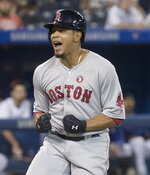 Boston Red Sox's Marco Hernandez reacts after hitting a home run against the Toronto Blue Jays during the ninth inning of a baseball game Thursday, July 4, 2019, in Toronto. (Fred Thornhill/The Canadian Press via AP)