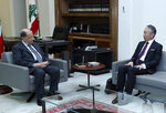 In this photo released by Lebanon's official government photographer Dalati Nohra, Lebanese president Michel Aoun, left, meets with Japan's Ambassador to Lebanon Takeshi Okubo in the presidential palace, in Baabda, east of Beirut, Lebanon, Monday, Sept. 2, 2019. The Lebanese presidential palace said Tuesday that Lebanon's president met with the Japanese ambassador and they discussed the case, but did not provide any other details. This is the first known meeting between the president and a Japanese diplomat since Ghosn arrived in the country on Dec. 30. (Dalati Nohra via AP)