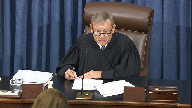 In this image from video, presiding officer Supreme Court Chief Justice John Roberts speaks during the impeachment trial against President Donald Trump in the Senate at the U.S. Capitol in Washington, Tuesday, Jan. 21, 2020. (Senate Television via AP)