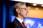 U.S. special representative on Iran Brian Hook appears on stage with Secretary of State Mike Pompeo as he speaks at a news conference at the State Department in Washington, Monday, Nov. 18, 2019. Pompeo spoke about Iran, Iraq, Israeli settlements in the West Bank, protests in Hong Kong, and Bolivia, among other topics. (AP Photo/Andrew Harnik)