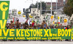 FILE - In this Aug. 6, 2017 file photo, demonstrators against the Keystone XL pipeline march in Lincoln, Neb.The Trump administration is approving a right-of-way allowing the Keystone XL oil sands pipeline to be built across U.S. land. Federal officials told The Associated Press that Interior Secretary David Bernhardt would sign the approval for about 45 miles of the line's route Wednesday, Jan. 22, 2020. It pushes the controversial $8 billion project closer to construction, but it still faces court challenges. A lawsuit challenging the pipeline is pending before a federal judge in Montana who has previously ruled against the project. The 1,200-mile pipeline would transport up to 830,000 barrels of crude oil daily from western Canada to U.S. refineries. (AP Photo/Nati Harnik, File)