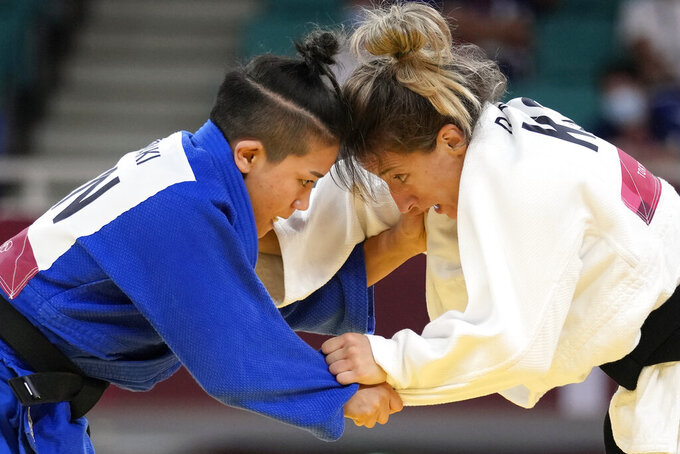 Funa Tonaki of Japan, left, and Distria Krasniqi of Kosovo compete during their women's -48kg championship judo match at the 2020 Summer Olympics, Saturday, July 24, 2021, in Tokyo, Japan. (AP Photo/Vincent Thian)