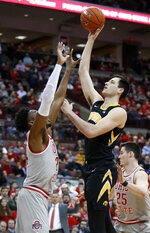 Iowa forward Ryan Kriener, right, goes up for a shot against Ohio State forward Andre Wesson during the first half of an NCAA college basketball game in Columbus, Ohio, Tuesday, Feb. 26, 2019. (AP Photo/Paul Vernon)