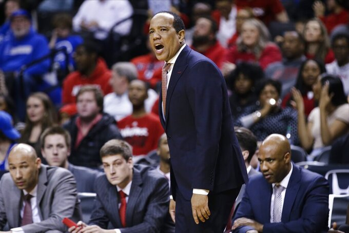 North Carolina State head coach Kevin Keatts calls to his team during the second half of an NCAA college basketball game against Memphis in the Barclays Classic, Thursday, Nov. 28, 2019, in New York. (AP Photo/Frank Franklin II)