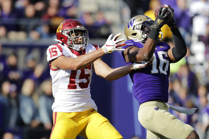 Washington's Cameron Williams (16) intercepts a pass intended for Southern Cal's Drake London (15) late in the second half of an NCAA college football game Saturday, Sept. 28, 2019, in Seattle. Washington won 28-14. (AP Photo/Elaine Thompson)