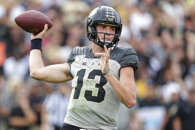 Purdue quarterback Jack Plummer (13) throws against Minnesota during the first half of an NCAA college football game in West Lafayette, Ind., Saturday, Sept. 28, 2019. (AP Photo/Michael Conroy)