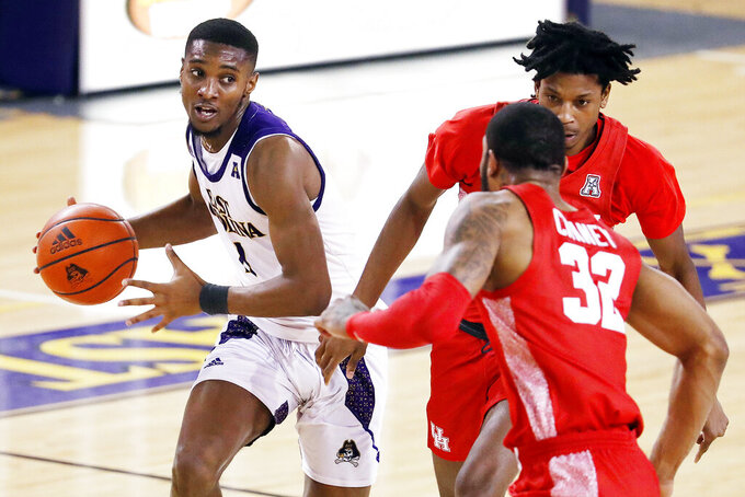 East Carolina's J.J. Miles (11) drives the ball past Houston's Tramon Mark (12) to be challenged by Houston's Reggie Chaney (32) during the second half of an NCAA college basketball game in Greenville, N.C., Wednesday, Feb. 3, 2021. (AP Photo/Karl B DeBlaker)