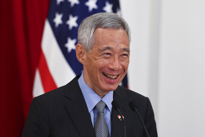 Singapore's Prime Minister Lee Hsien Loong attends a joint news conference with U.S. Vice President Kamala Harris in Singapore Monday, Aug. 23, 2021. (Evelyn Hockstein/Pool Photo via AP)