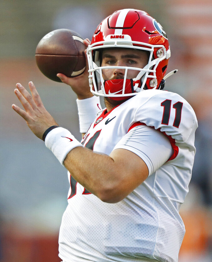 FILE - In this Oct. 5, 2019, file photo, Georgia quarterback Jake Fromm (11) throws to a receiver during warmups before an NCAA college football game against Tennessee, in Knoxville, Tenn. The SEC hasn't had a quarterback picked in the first round of the NFL draft since Johnny Manziel in 2014, and the league has never had more than one quarterback taken in the first round. It appears that's about to change, as Tua Tagovailoa, Joe Burrow and possibly Jake Fromm could make the next draft the best ever for SEC quarterbacks. (AP Photo/Wade Payne, File)