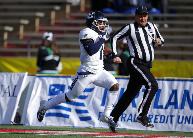 Utah State wide receiver Aaren Vaughns sprints to the end zone to score a touchdown against North Texas during the first half of the New Mexico Bowl NCAA college football game in Albuquerque, N.M., Saturday, Dec. 15, 2018. (AP Photo/Andres Leighton)
