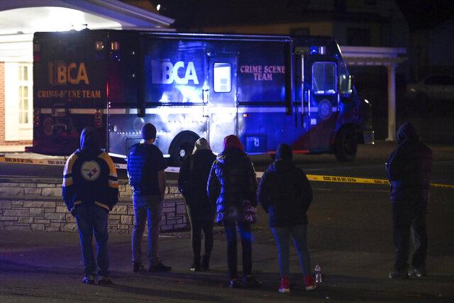A crowd gathers on Sunday, Nov. 29, 2020, along Rice Street near the scene where St. Paul Police shot a man earlier in the night in St. Paul, Minn. (Aaron Lavinsky/Star Tribune via AP)