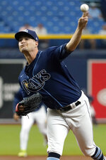 Tampa Bay Rays starting pitcher Shane McClanahan delivers to the Baltimore Orioles during the first inning of a baseball game Thursday, Aug. 19, 2021, in St. Petersburg, Fla. (AP Photo/Chris O'Meara)