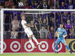 LA Galaxy's Efrain Alvarez, left, clears the ball from the goal area as goalkeeper David Bingham watches during the second half of the team's MLS soccer match against Orlando City, Friday, May 24, 2019, in Orlando, Fla. (AP Photo/John Raoux)