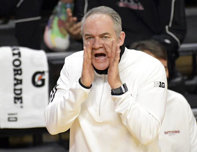 Rutgers head coach Steve Pikiell shout instructions during the first half of an NCAA college basketball game against Illinois, Sunday, Dec. 20, 2020, in Piscataway, N.J. (AP Photo/Bill Kostroun)