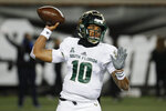 South Florida quarterback Chris Oladokun passes during the first half of an NCAA college football game against the Cincinnati, Saturday, Nov. 10, 2018, in Cincinnati. (AP Photo/John Minchillo)