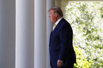 President Donald Trump walks through the Colonnade at the White House as he heads to the Rose Garden, Friday June 14, 2019, in Washington. (AP Photo/Jacquelyn Martin)