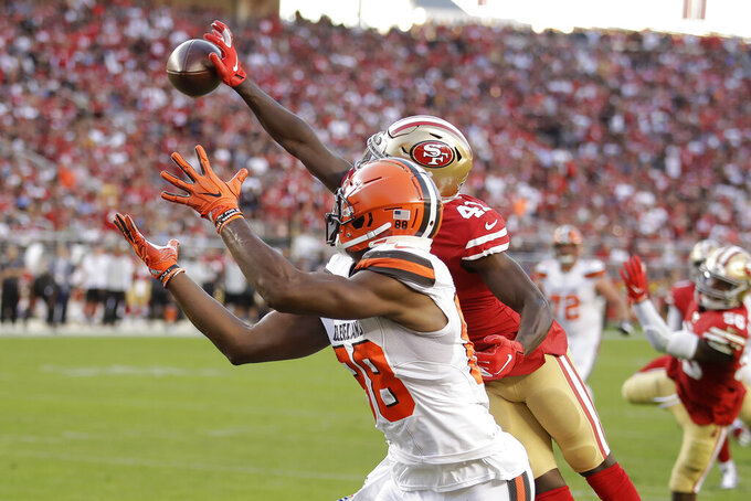 San Francisco 49ers defensive back Emmanuel Moseley, top, breaks up a pass intended fo Cleveland Browns tight end Demetrius Harris during the first half of an NFL football game in Santa Clara, Calif., Monday, Oct. 7, 2019. (AP Photo/Ben Margot)