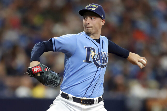 Tampa Bay Rays starting pitcher Blake Snell throws against the Texas Rangers during the second inning of a baseball game Sunday, June 30, 2019, in St. Petersburg, Fla. (AP Photo/Mike Carlson)