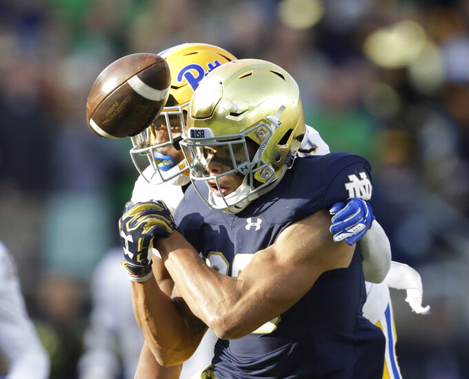 Pittsburgh defensive back Dane Jackson (11) is called for pass interference against Notre Dame wide receiver Chase Claypool (83) during the second half of an NCAA college football game, Saturday, Oct. 13, 2018, in South Bend, Ind. Notre Dame won 19-14. (AP Photo/Darron Cummings)
