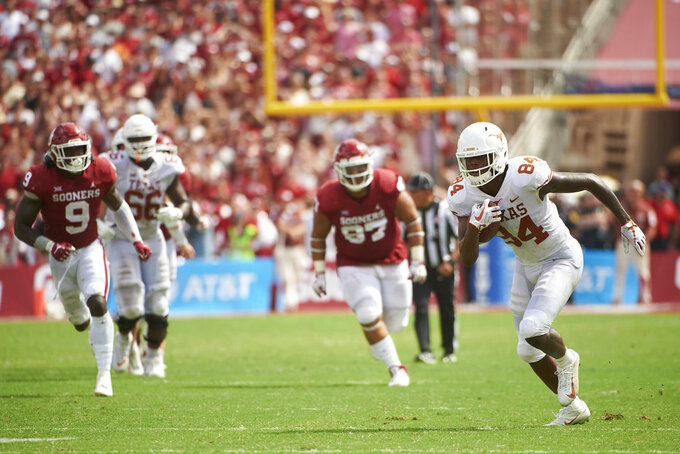 Texas wide receiver Lil'Jordan Humphrey (84) breaks free against Oklahoma during the second half of an NCAA college football game at the Cotton Bowl, Saturday, Oct. 6, 2018, in Dallas. (AP Photo/Cooper Neill)