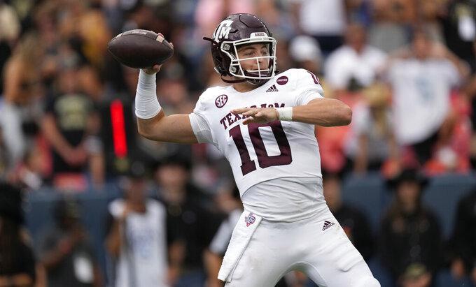 Texas A&M quarterback Zach Calzada passes the ball against Colorado in the first half of an NCAA college football game Saturday, Sept. 11, 2021, in Denver. (AP Photo/David Zalubowski)