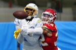 Kansas City Chiefs free safety Tyrann Mathieu, right, breaks up a pass intended for Los Angeles Chargers wide receiver Mike Williams during the first half of an NFL football game Sunday, Sept. 20, 2020, in Inglewood, Calif. (AP Photo/Ashley Landis )